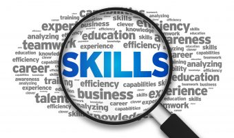 Magnified with the word Skills